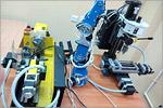 Гибкая производственная система на базе двух станков с компьютерным управлением и учебного робота. Открыть в новом окне [80Kb]